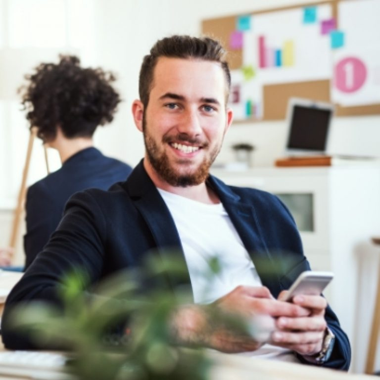 a-portrait-of-young-businessman-with-smartphone-A2GKEC4.jpg